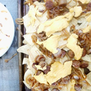 Beer Brat Nachos with Caramelized Onions and Mustard-Cheddar Sauce (A Gluten-Free Oktoberfest Treat)