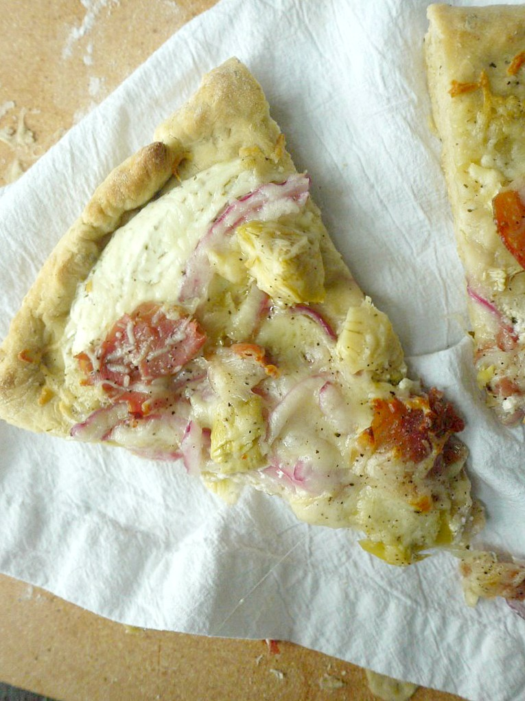 artichoke and prosciutto pizza with yogurt-feta sauce 15