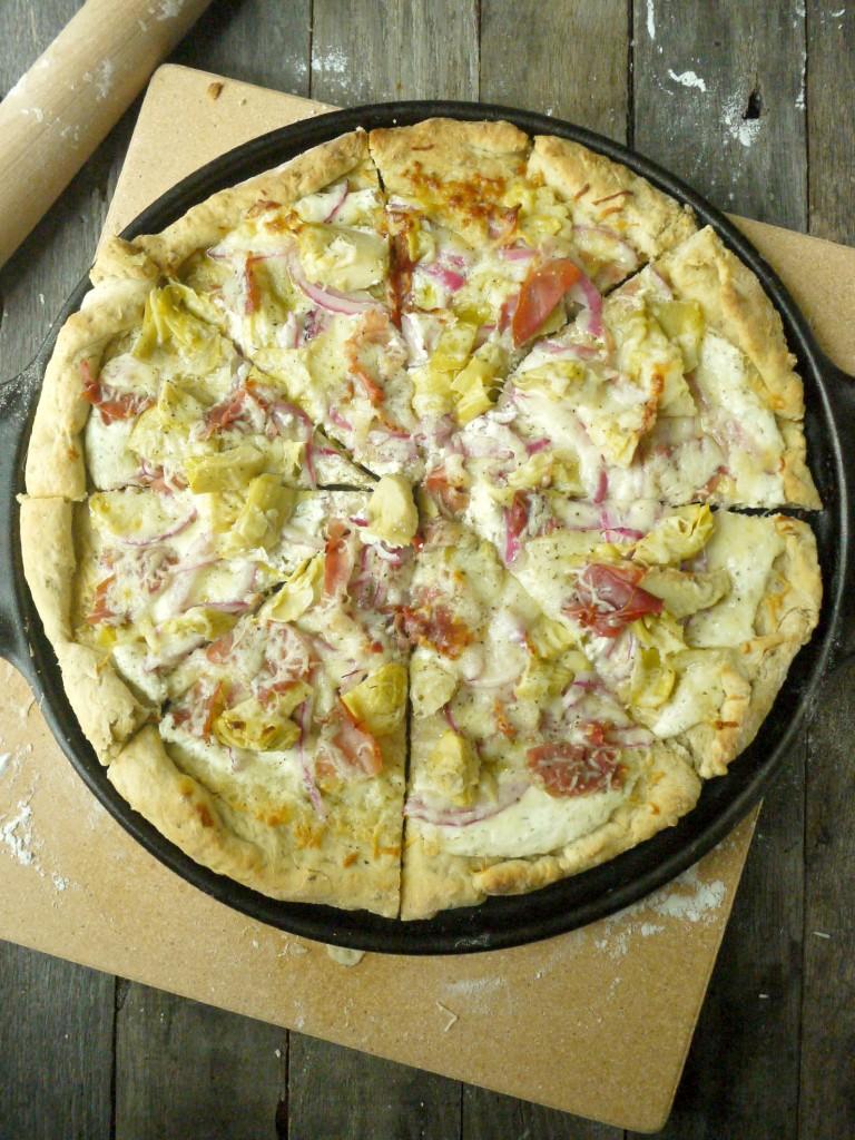artichoke and prosciutto pizza with yogurt-feta sauce 4