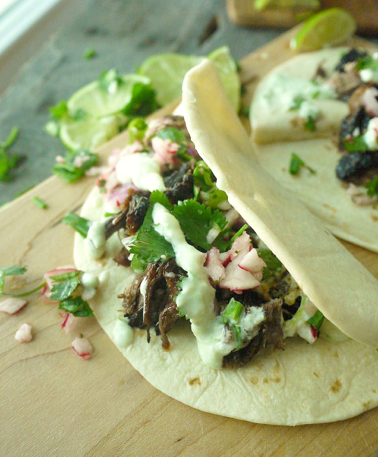 beer braised lamb tacos with chive tzatziki 12