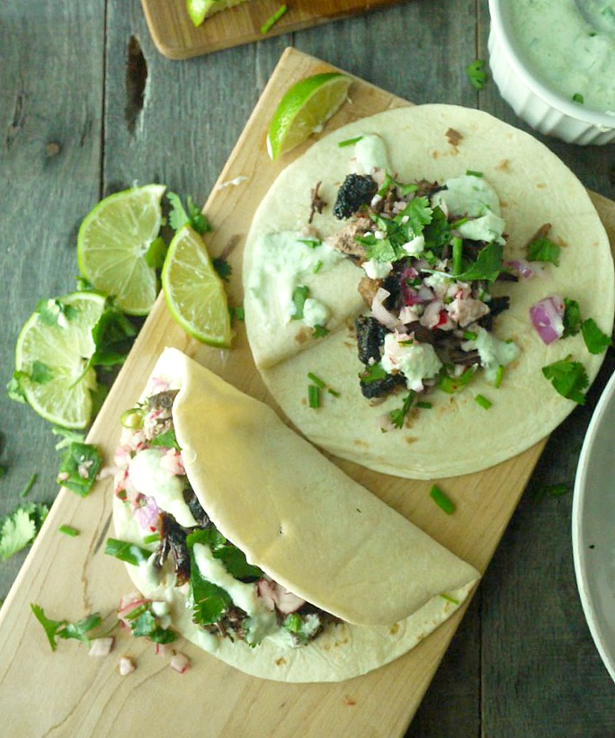 beer braised lamb tacos with chive tzatziki 13